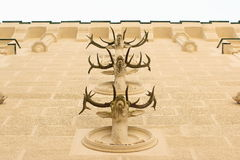 Deers antlers at Hluboka castle. Multilevel deer's antlers as exterior building ornament at Hluboka Castle, Czech Republic Royalty Free Stock Photography