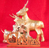 Deers and christmas sign. Raindeer with chrismas sing and red background Stock Images
