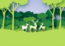 Deers family and nature forest landscape paper art style. Royalty Free Stock Images