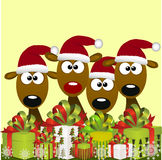 Deers with red santa hat Royalty Free Stock Images