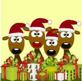 Deers with red santa hat Stock Images