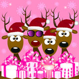 Deers with red santa hat Stock Photos