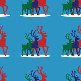 Deers seamless pattern. Three deer on a blue background.  It can be used as  seamless texture Stock Photos