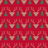 Deers and Xmas Trees seamless pattern on red background. Stock Photos