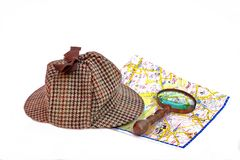 Deerstalker cap, magnifying glass and London map Stock Photography