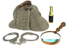 Deerstalker Hat, Magnifer, Handcuffs and Spyglass Royalty Free Stock Photography