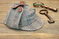 Deerstalker Hat, Retro Magnifying Glass and Large Old Key Stock Photography