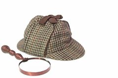 Deerstalker Hat and Retro Magnifying Glass Royalty Free Stock Photography