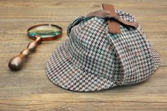 Deerstalker Hat and Retro Magnifying Glass Stock Image