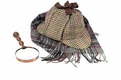 Deerstalker Hat, Retro Magnifying Glass and Woolen Tartan Scarf Royalty Free Stock Photo