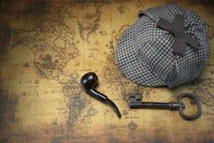 Deerstalker Sherlock Hat, Vintage Key, Smoking Pipe On Old Map. Royalty Free Stock Image