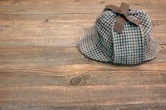 Deerstalker or Sherlock Hat on Wooden Table Stock Photography