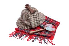 Deerstalker or Sherlock Holmes cap cap, magnifying glass, tartan Royalty Free Stock Images