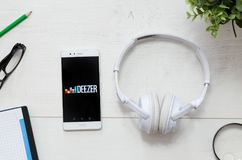Deezer is a service that offers legal streaming music. WROCLAW, POLAND - MARCH 29, 2018: Deezer is a music service that offers legal streaming music. Smartphone stock photo