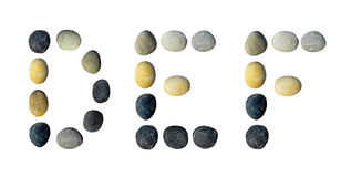 DEF letters made of pebbles. DEF letters made of pebbles on a white background Stock Photo