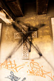 Defaced Cross. A cross defaced with some graffiti that I found in Venice Stock Photo