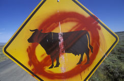 A defaced roadside sign Stock Photography