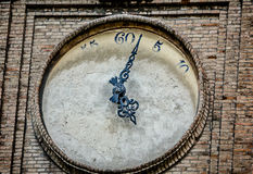 Defaced turret clock. Close-up of a turret clock with painted-over clock face in Parma, Italy Stock Photography