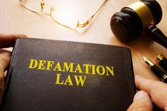 Defamation Law. Defamation Law and gavel on a table stock photo