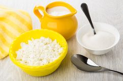 Defatted cottage cheese, napkin, jug with yogurt, bowl with suga Stock Photos