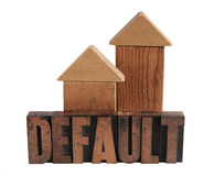 Default in wood type 1. The word default in old letterpress wood letters with two shapes in wood blocks that could be either houses or arrows pointing upward Royalty Free Stock Photos