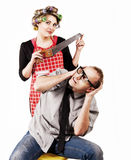 Defaulter husband and wife with hacksaw. Concept family scene. Defaulter husband and wife with hacksaw Stock Image