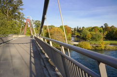 Defazio bike bridge. A view of the popular Peter DeFazio bike and footbridge in late fall. It spans the Willamette River in Eugene, Oregon and connects the bike Royalty Free Stock Images