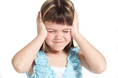Defeaning noise. A young girl suffering from noise. All isolated on white background Stock Images