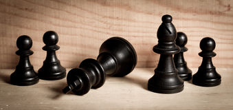 Defeat. King knocked over in chess defeat / checkmate stock photo