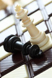 Defeat (chess on the chocolate chessboard). Defeat. Chess on the chocolate chessboard. Close-up Royalty Free Stock Photography