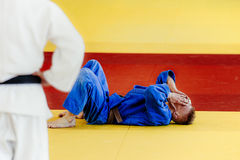 Defeat fighter judoka. Win by IPPON on tatami competition judo royalty free stock photography