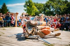 Defeated In Battle Knight Tries To Get Up From The. MINSK, BELARUS - JULY 19, 2014 Historical restoration of knightly fights on festival of medieval culture Stock Photography