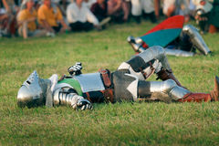 Defeated knight. GRUNWALD - JULY 17: Defeated knight lying on the ground - Battle of Grunwald 1410, 600th anniversary. July 17, 2010 in Grunwald, Poland Royalty Free Stock Photography