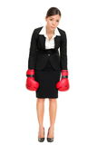 Defeated loser woman - business concept. With businesswoman wearing boxing gloves standing in full body looking hopeless. Young Asian / Caucasian female Stock Image