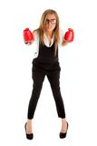 Defeated loser woman - business concept with businesswoman weari. Ng boxing gloves standing in full body looking hopeless Royalty Free Stock Photo