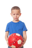 Defeated soccer player. Young defeated soccer player on isolated white stock image