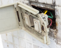 Defective electrical wall fixture. Royalty Free Stock Image