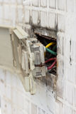 Defective electrical wall fixture. Royalty Free Stock Images