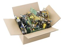 Defective Printed Circuit Boards In Box Stock Photos