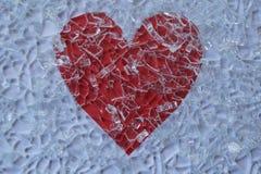 Defektes Glas und Herz Stockfoto