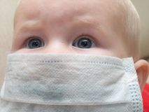 Defence for baby. Little baby in a medical mask Stock Photos
