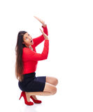 Defence business Woman. Woman in red is defending herself isolated on white Royalty Free Stock Photography