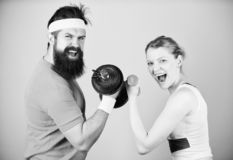 Defend til the End. Sporty couple training in gym. Sport dumbbell equipment. Athletic fitness competition. Weight royalty free stock photography