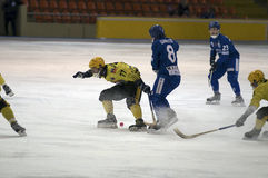 Defender blocks the attacker. MOSCOW - FEBRUARY 22: Hockey match Dynamo (blue) - Moorman (yellow) in ice sports palace Krylatskoye on February 22, 2012 in Moscow royalty free stock photography