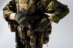 Defender hands holding fragmentation grenade Stock Images