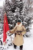 Defender of Stalingrad in a winter form with a red banner Royalty Free Stock Photography