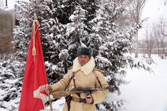 Defender of Stalingrad in a winter form with a red banner Royalty Free Stock Photo