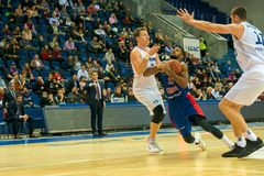 The defender stopped the attacker. MOSCOW, RUSSIA - OCTOBER 29, 2018: Cory Higgins 22 in a basketball game CSKA vs Parma Perm on the regular championship of the royalty free stock photo