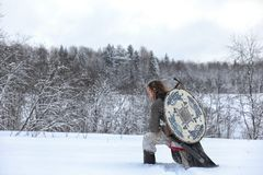 Defender the young warrior in mail armor Royalty Free Stock Photo