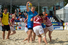 Defenders can not cope. MOSCOW, RUSSIA - JULY 22-23, 2017: Rugby players in action at the  on European Beach Fives Rugby Championship 2017 in the match Russia Stock Image
